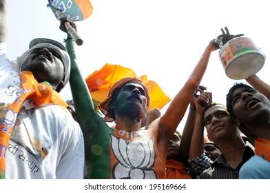 VARANASI - MAY 8:  BJP supporters chanting slogans during a political rally on May 8, 2014 in Varanasi , India.