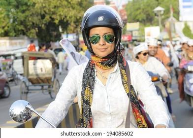 VARANASI - MAY  8:  Bollywood actress  Gul Panag  riding a motorbike  during a  motorbike rally  on May  8, 2014 in Varanasi , India.