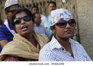 VARANASI - MAY  8:   Indian women and AAP supporters participating in a motorbike rally  on May  8, 2014 in Varanasi , India.