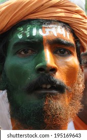 VARANASI - MAY 8:  Portrait of a  BJP supporter painted in BJP colour  on his head on May 8, 2014 in Varanasi , India.