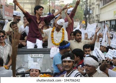 VARANASI - MAY 9: Arvind Kejriwal and  Kumar Viswas amongst sea of supporters during a political rally on May 9, 2014 in Varanasi , India.
