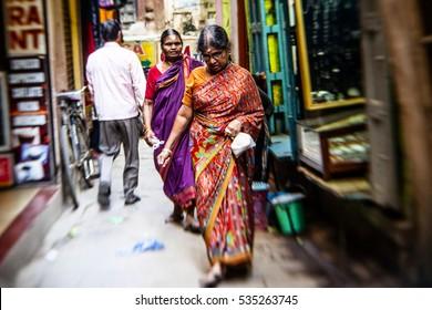 VARANASI - NOVEMBER 22: Unidentified hindu woman on the streets of sacred Varanasi old town on November 22, 2012 in Varanasi, State of Uttar Pradesh, India