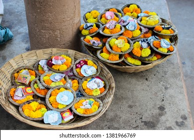 Varanasi, Uttar Pradesh - 20.04.2019 : Two baskets of oil lamps adorned by marigold flowers on sell for floating on the ganges as prayer in the ghats of Varanasi after ganga arti.
