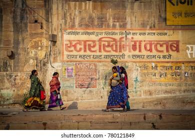 Varanasi, Uttar Pradesh, India - December 15, 2015 : Crossing women at banks of ganga river.