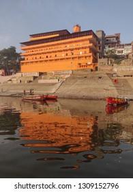 Varanasi, Uttar Pradesh / India - February 01 2019: A view of the Dadi Ghat with its reflection in River Ganga at Varanasi
