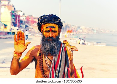 VARANASI, UTTAR PRADESH / INDIA - JANUARY 8, 2019: Sadhu welcomes You on ghats of Kashi