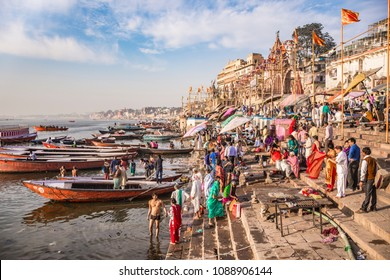 Varanasi, Uttar Pradesh, India- March 15 2017: Panoramic view of the sacred city of Varanasi with people taking morning bath at the ganges river.