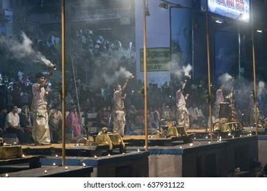 VARANASI, UTTAR PRADESH / INDIA - MAY 7, 2015 : PEOPLE ARE GATHER TO WATCH THE GANGA AARTI AT GHAT DURING THE EVENING.