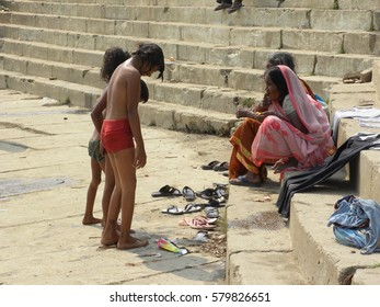 Varanasi, Uttar Pradesh, India - Nov 2, 2009 Young girls after taking a bath on river Ganga with their families on the ghats