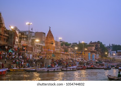 Varanasi, Uttar Pradesh, India - October 23, 2017:  Dashashwamedh Ghat on Ganges river, one of famous and holy place for pilgrims to take baht.