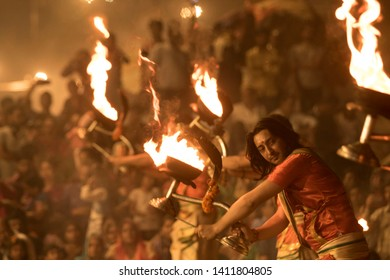 Varanasi, Uttar Pradesh / India - OCTOBER 14, 2018: The monk doing Ganga Aarti with ultimate passion. This is one of the rituals here which attracts thousands of people around the globe.