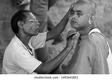 Varanasi, Uttar Pradesh / India - October 16, 2018: Roadside barber shops are part of old traditions of Indian culture and Varanasi being the oldest living city still holds this tradition strongly.