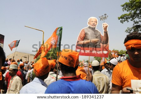 VARANASI-APRIL 24: Narendra Modi supporters walking in a political rally  in his support  on April  24, 2014 in Varanasi , India.