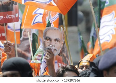 VARANASI-APRIL 24: People listening to Narendra Modi  during a rally in his support  on April  24, 2014 in Varanasi , India.