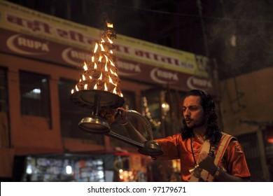 VARANASI-FEB17: Hindu people, doing the ceremony fire-puja on Feb17, 2012 Raja Ghat Uttar Pradesh Varanasi India.