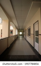 Varanasi,India Oct-19 2020:  Interior of a school corridor with selective focus and copy space during Covid in india.A long empty corridor with white walls.The concept of quarantine.