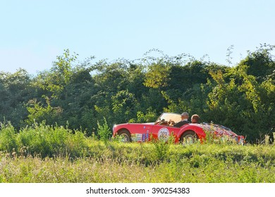 VARANO (PR), ITALY - SEPTEMBER 18: A bright red MG A Roadster takes part to the GP Nuvolari classic car race on September 18, 2015 near Varano (PR). The car was built in 1957.