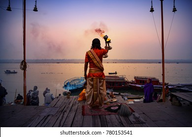 Varansai, Uttar Pradesh, India - December 15, 2015 : Hindu priests perform an Arti worship ceremony at  Ganges River.