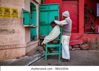 Varansai, Uttar Pradesh, India - December 15, 2015 : Barber shop at bank of river ganga.