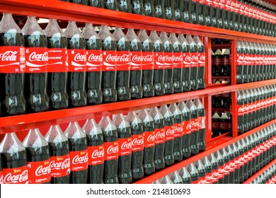 VARAZDIN, CROATIA - AUGUST 31, 2014: Plastic bottles of Coca Cola on display on Coca Cola stand during Varazdin Spanirfest festival. Coca Cola Company is leading soda drinks manufacturer in the world.