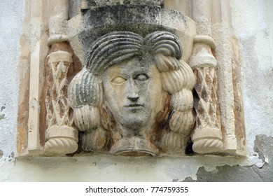 VARAZDIN, CROATIA - JULY 09: Architectural detail with a mascaron of a woman on the facade of an old building in Varazdin, Croatia on July 09, 2016.