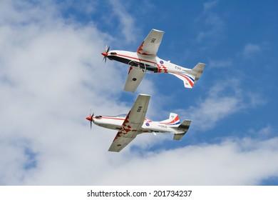 VARAZDIN, CROATIA - JULY 11, 2009: Croatian International Air Show Varazdin. Aerobatic display team Wings of storm consist of Pilatus PC-9M performing on air show.