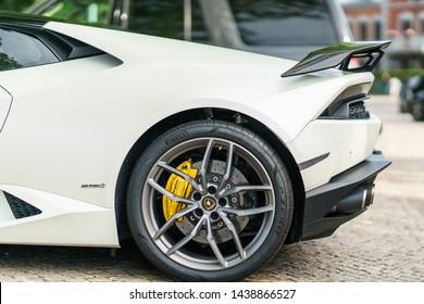 Varberg, Sweden - June 23, 2019 : Parking car in street at sea side town Verberg, White color Lamborghini Huracan is famous supercar