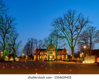 Varel, Germany - March 30, 2019: Schlossplatz (castle square) and local court in the evening during blue hour, trees are leafless