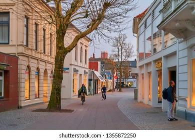 Varel, Germany - March 30, 2019: pedestrian zone at beginning dawn