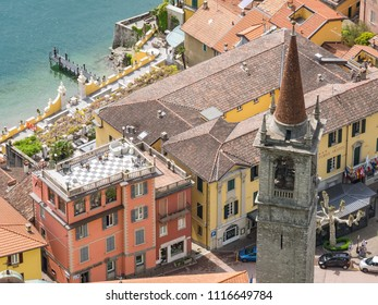VARENA, ITALY - APRIL 29th 2018: The center of the  Italian town of Varena by the Como lake shot from the above on a sunny spring day.