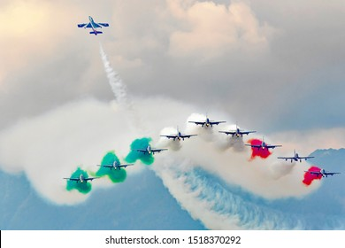 Varenna - Como Lake -  September 29, 2019 Acrobatic air performance of Frecce tricolori (tricolour arrows) in the sky. Frecce Tricolori, is the aerobatic demonstration team of the Italian Air Force.