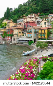 VARENNA, ITALY - AUGUST 17, 2019: Panoramic view of Lago di Como in Northern Italy and the beautiful village of Varenna.