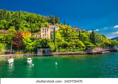 VARENNA, ITALY - June 1, 2019 - Varenna old town with the mountains in the background, Italy, Europe.