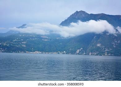 Varenna town italy como lake harbor boats