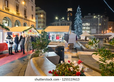 Varese, Italy - December 07, 2018: Christmas market in the evening. Stalls in a city of northern Italy. Varese and square Monte Grappa in the historic center