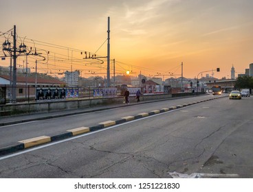 Varese, Italy - December 6, 2018: View of Main street with Railway station at sunset in the center of Varese, Italy