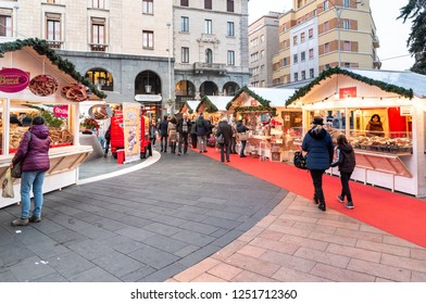 Varese, Italy - December 6, 2018: People visiting Christmas Market on the Monte Grappa square in the center of Varese, Italy