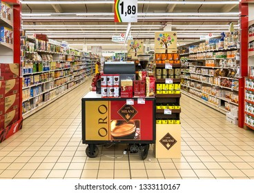 Varese, Italy - Marc 7, 2019: Lanes of shelves with goods products inside of the IPER of Varese hypermarket. Breakfast department with coffee counter in promotion.