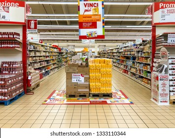 Varese, Italy - Marc 7, 2019: Lanes of shelves with goods products inside of the IPER of Varese hypermarket. Breakfast department with bread and flour counter in promotion.