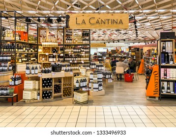 Varese, Italy - Marc 7, 2019: Wine department with a wide display of wine bottles inside of the IPER of Varese hypermarket, interior of the shopping center, Varese, Italy