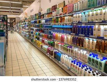 Varese, Italy - Marc 7, 2019: Lanes of shelves with Hygienic products various brands and manufacturers inside of the IPER of Varese hypermarket.