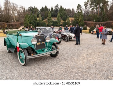 Varese, Italy - March 2, 2019: Demonstration parade of the Historic Cars in the Gardens of Estense Palace (Palazzo Estense) in Varese, Italy