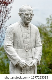 Varese, Italy - May 9, 2019: White marble statue of Monsignor Pasquale Macchi by Augusto Caravati in the Sacred Mount of Varese, Unesco World Heritage Site.