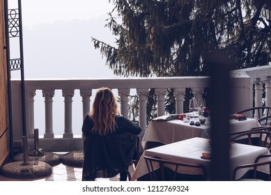 Varese OCT 2018 ITALY - back view of a sitting woman relaxing in a terrace after dinner