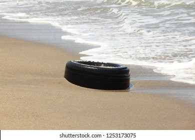 Vargas/ Venezuela - February 24th, 2017: A tire trash found in the during International Coastal beach cleanup day activity in La Guaira. Plastic from tyres major source of ocean pollution.