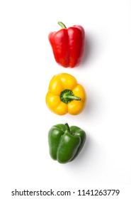 Variation of different color bell peppers on a white background. Colorful paprikas viewed from above isolated on white. Top view. Semaphore or traffic light concept.