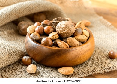 Variation of different nuts in front of a rustic background