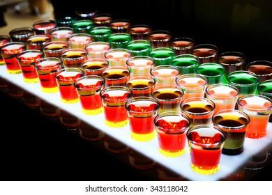 Variation of hard alcoholic shots served on bar counter.