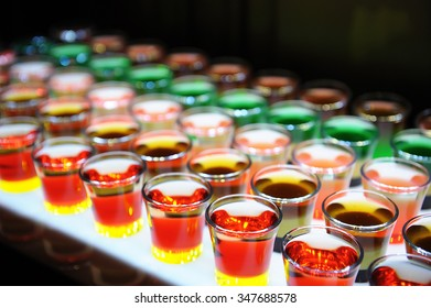 Variation of hard alcoholic shots served on bar counter.