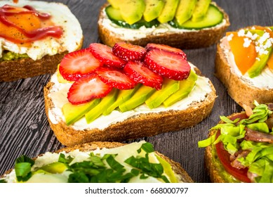 Variation of healthy rye breakfast sandwiches with avocado and with different ingredients.
